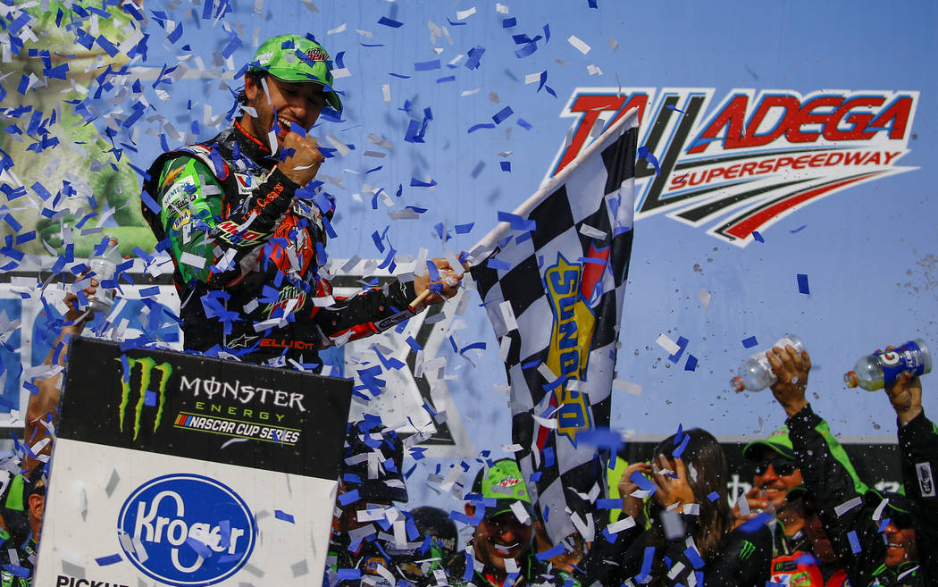 Chase Elliott, left, celebrates after winning a NASCAR Cup Series auto race at Talladega Supers ...