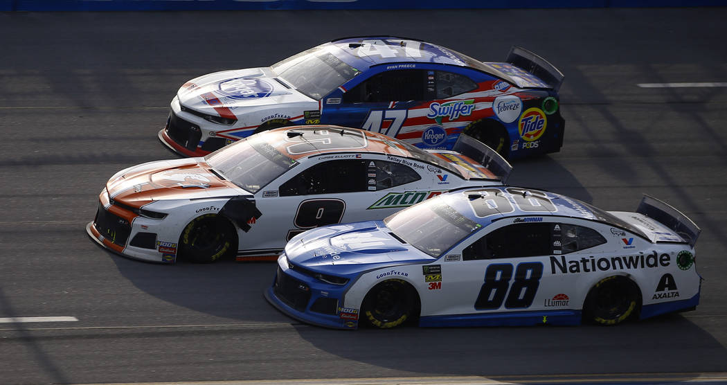 Chase Elliott (9) leads Alex Bowman (88) and Ryan Preece (47) to the finish line to win a NASCA ...