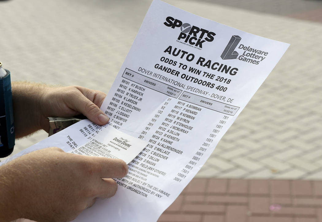 In this Oct. 7, 2018, file photo, an odds sheet and betting slip are seen at Dover Internationa ...