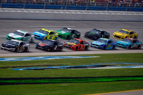 Aric Almirola (10) leads the pack as he wins Stage 1 during a NASCAR Cup Series auto race at Ta ...