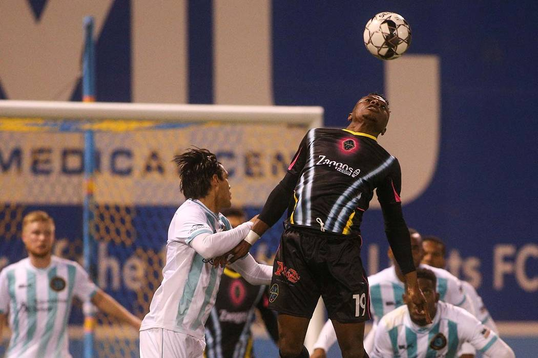 Las Vegas Lights FC forward Tabort Etaka Preston (19) jumps up to head the ball during the seco ...