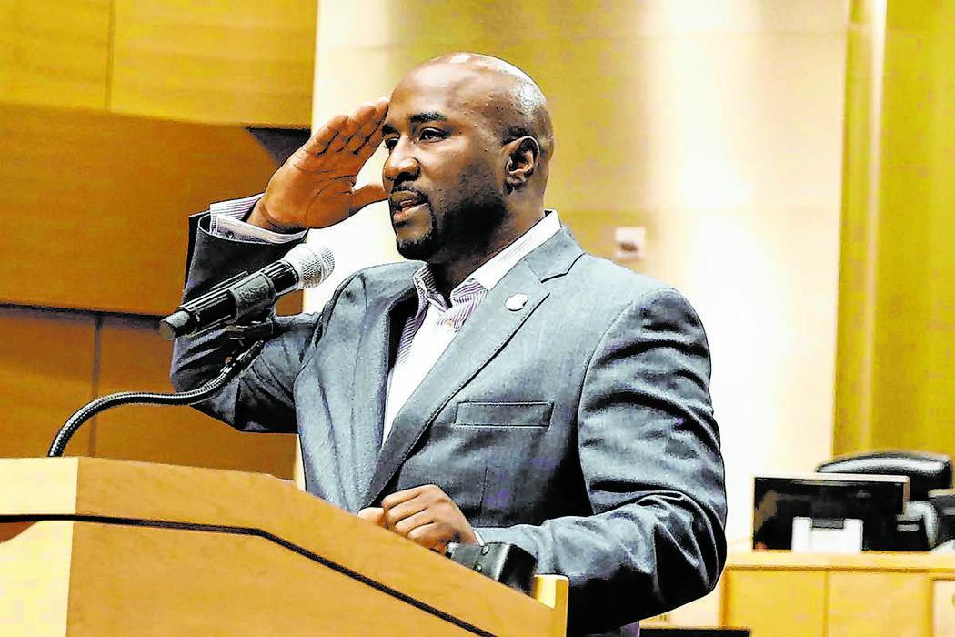 Las Vegas City Councilman Ricki Y. Barlow salutes after announcing his resignation during a pre ...