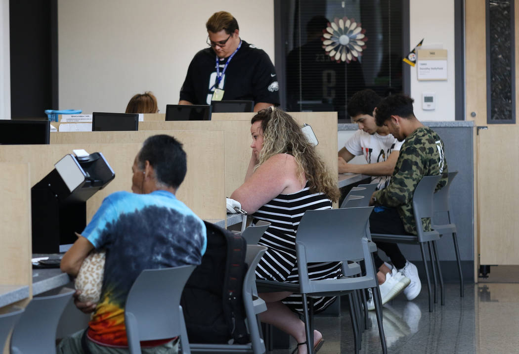 Customers are helped by DMV service technicians at Sahara DMV office on Friday, May 10, 2019, i ...