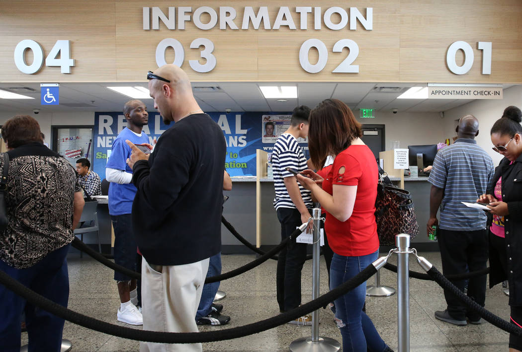 Customers wait in line the DMV at the East Sahara office on Friday, May 10, 2019, in Las Vegas. ...