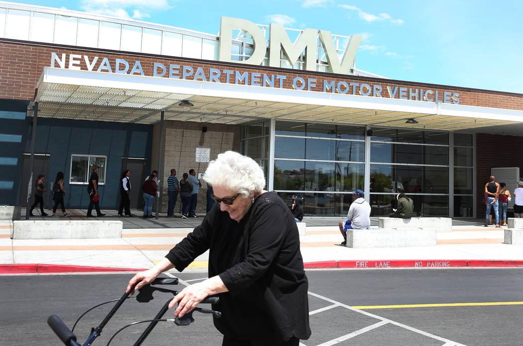 A customer walks past the DMV at East Sahara office on Friday, May 10, 2019, in Las Vegas. (Biz ...