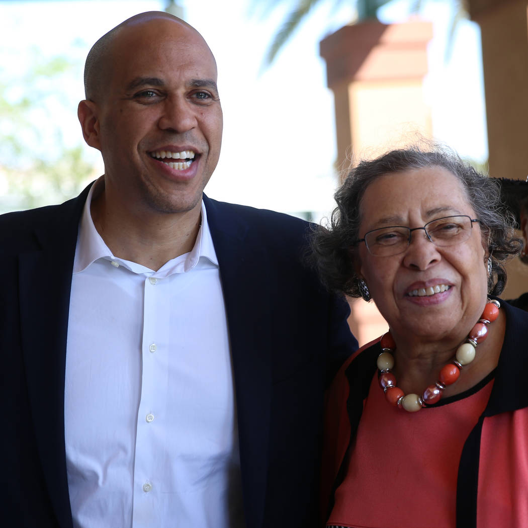 Democratic presidential candidate Sen. Cory Booker, D-N.J., left, with his mother Carolyn, take ...