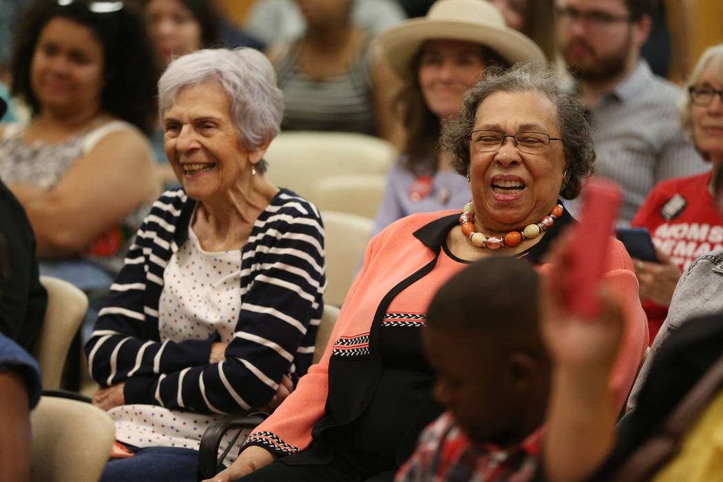 Carolyn Booker, right, laughs as his son, Democratic presidential candidate Sen. Cory Booker, D ...