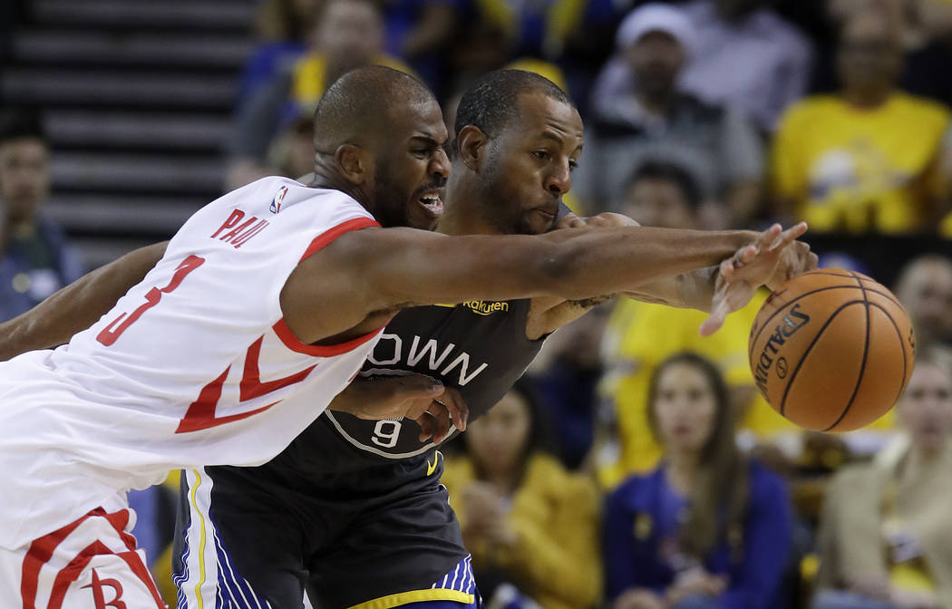 Golden State Warriors' Andre Iguodala, right, defends against Houston Rockets' Chris Paul durin ...