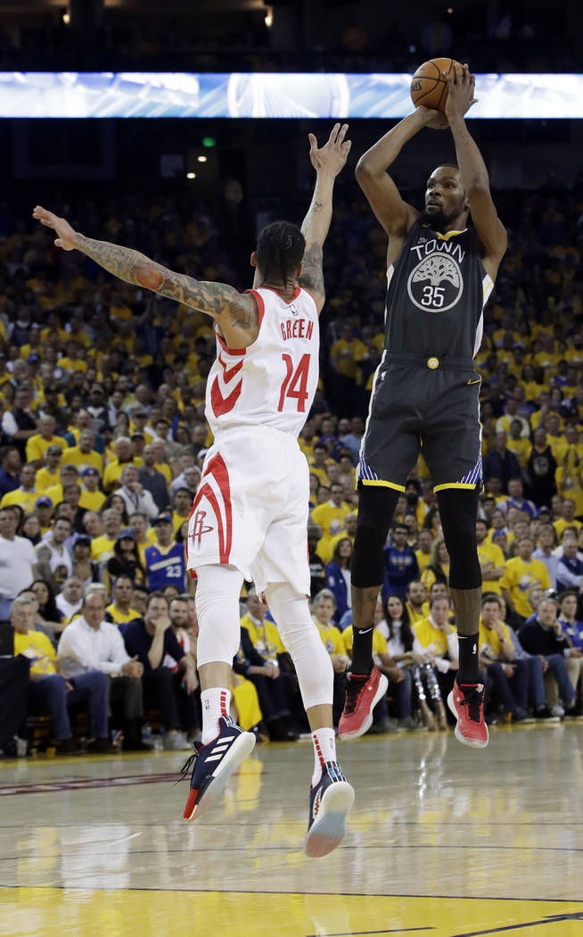 Golden State Warriors' Kevin Durant, right, shoots over Houston Rockets' Gerald Green during th ...