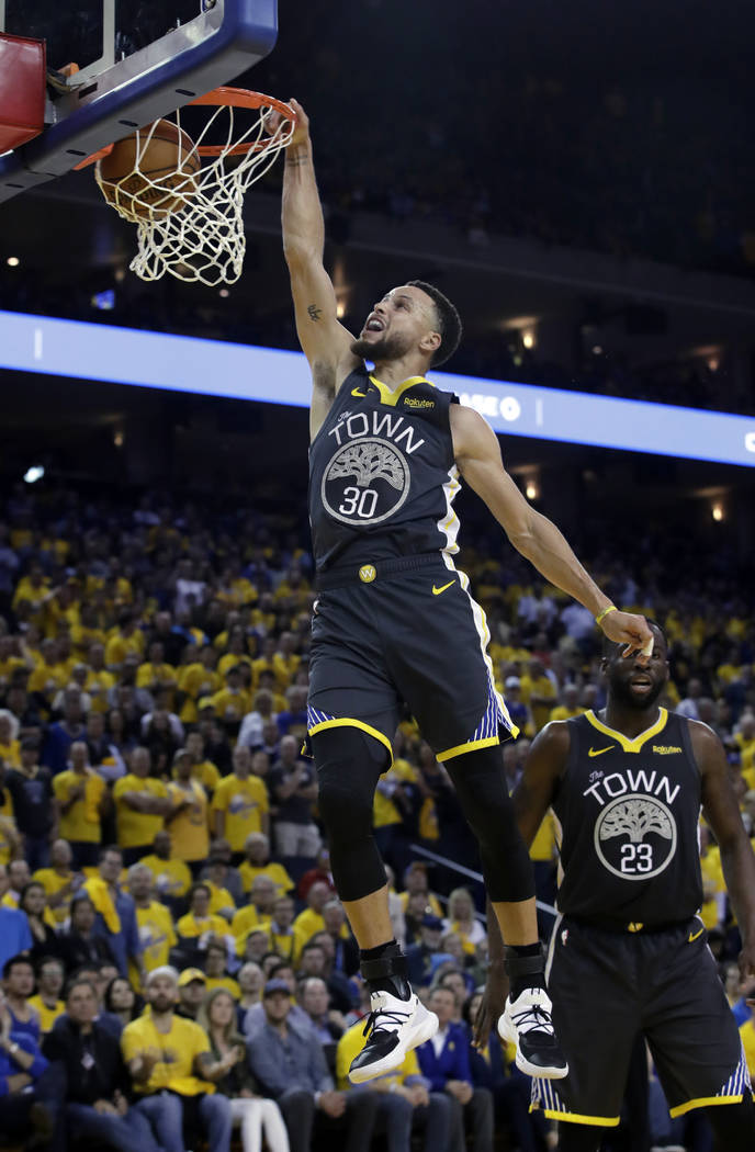 Golden State Warriors' Stephen Curry goes up for a dunk during the second half of Game 2 of a s ...