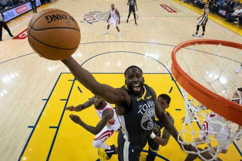 Golden State Warriors forward Draymond Green (23) grabs a rebound against the Houston Rockets d ...