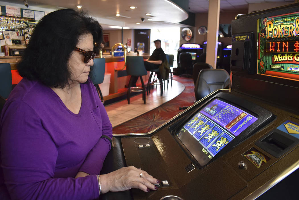 Lucille Brien plays a video poker machine at the Monte Bar and Casino in Billings, Montana, Tue ...