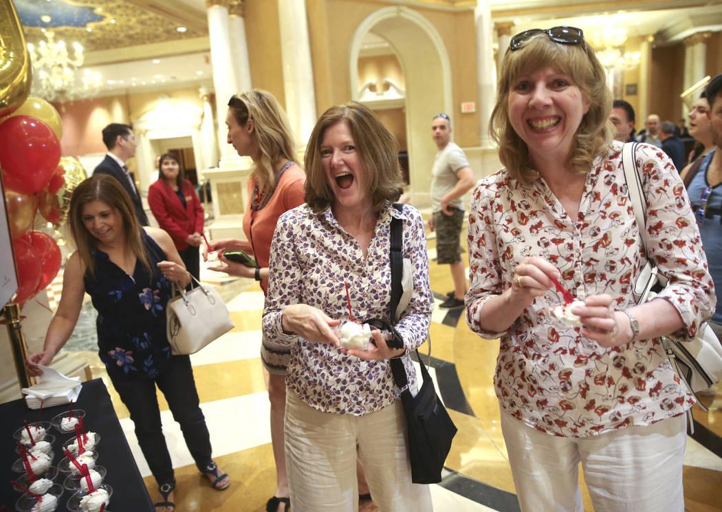 Liz Wilkinson, left, and Sally Evans of United Kingdom grab free gelato at The Venetian to cele ...