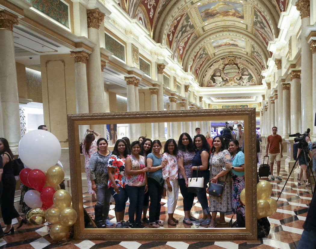 Friends pose in the Grand Colonnade at The Venetian to celebrate the 20th anniversary of the La ...