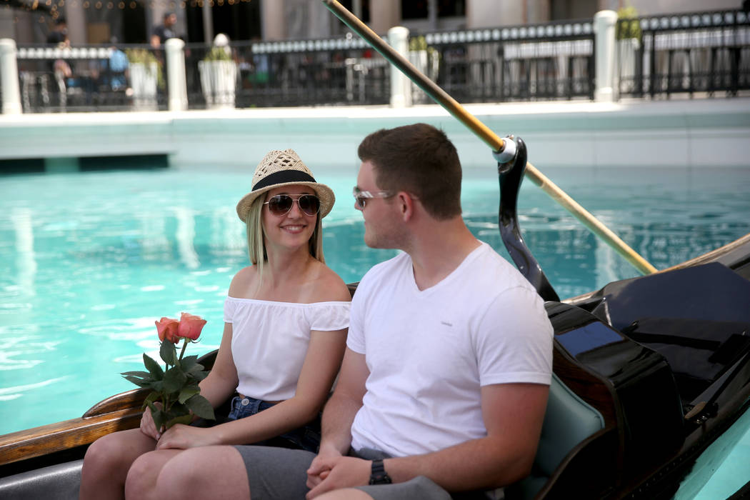 Shannon Terhaar and Layne Chapman of Minneapolis get free roses while taking a gondola ride at ...