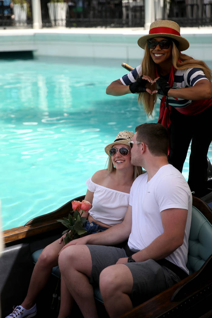 Shannon Terhaar and Layne Chapman of Minneapolis pose with gondolier Coco and free roses at The ...