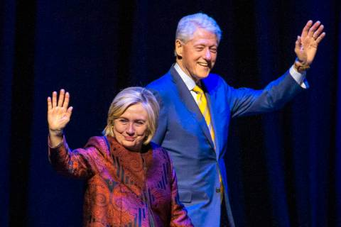 Former U.S. President Bill Clinton and former U.S. Secretary of State Hillary Clinton arrive on ...