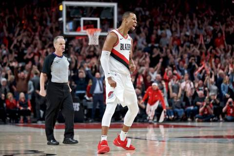Portland Trail Blazers guard Rodney Hood reacts after making a three point basket against the D ...