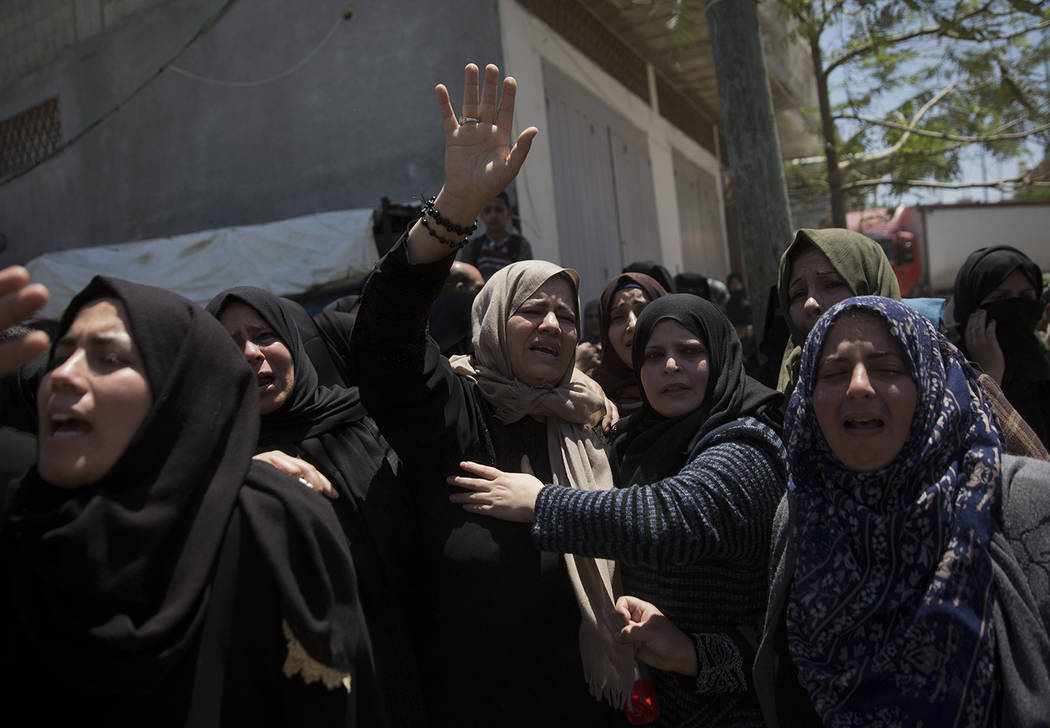 Relatives mourn Palestinian Raid Abu Tair, who was killed by Israeli troops during Friday's pro ...