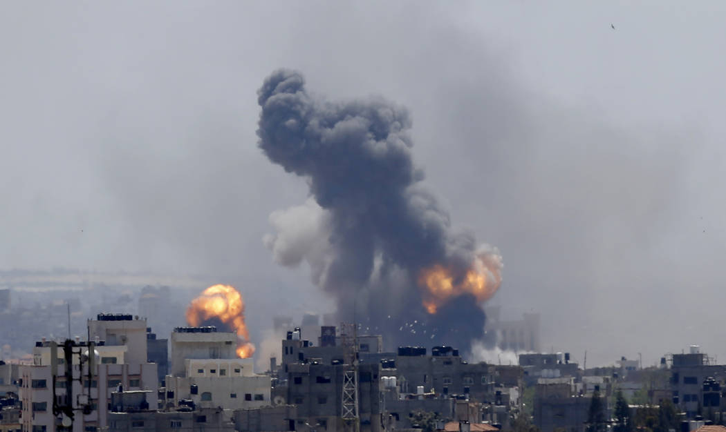 Smoke rises from an explosion caused by an Israeli airstrike in Gaza City, Saturday, May 4, 201 ...