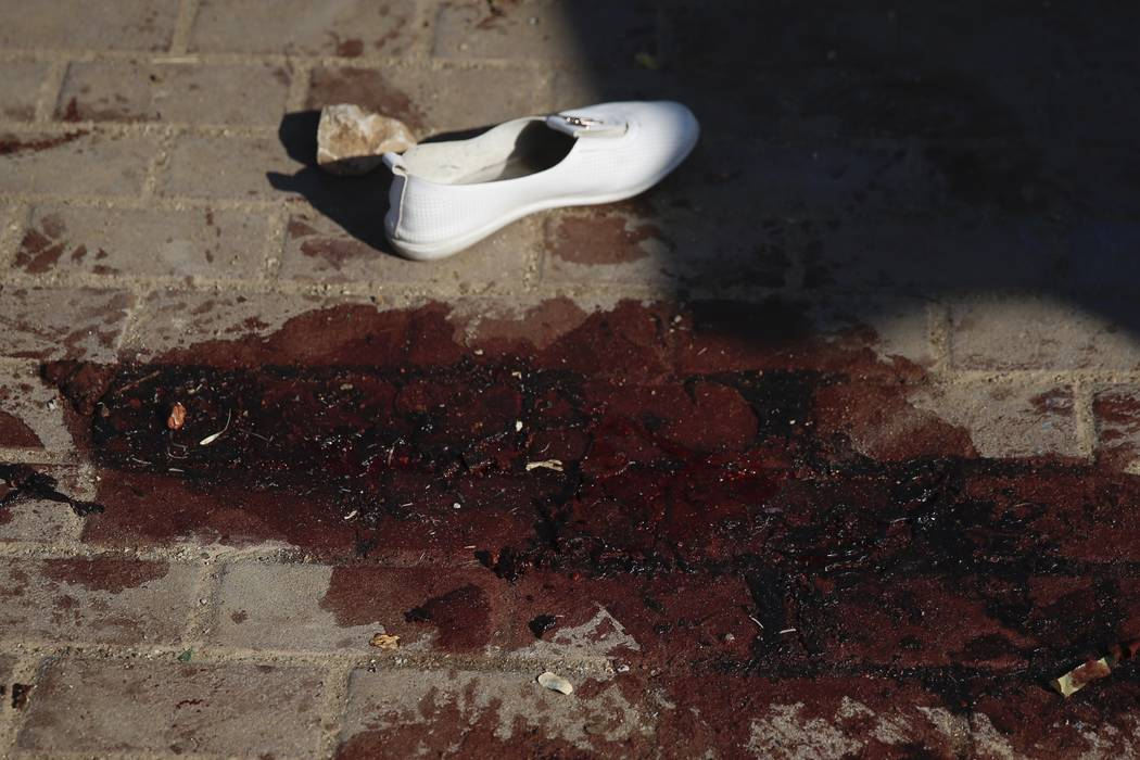 Blood stains and a shoe of a woman that was injured after a rocket fired from Gaza Strip hit in ...