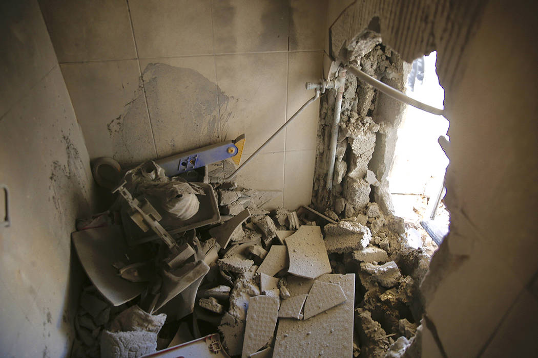 A damage to a house is seen after a rocket fired from Gaza Strip hit in the southern Israeli ci ...