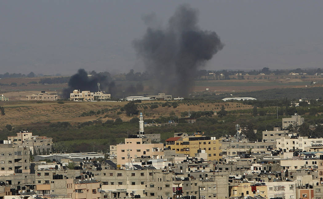 An explosion caused by Israeli airstrikes is seen in Gaza City, Saturday, May 4, 2019. Palestin ...
