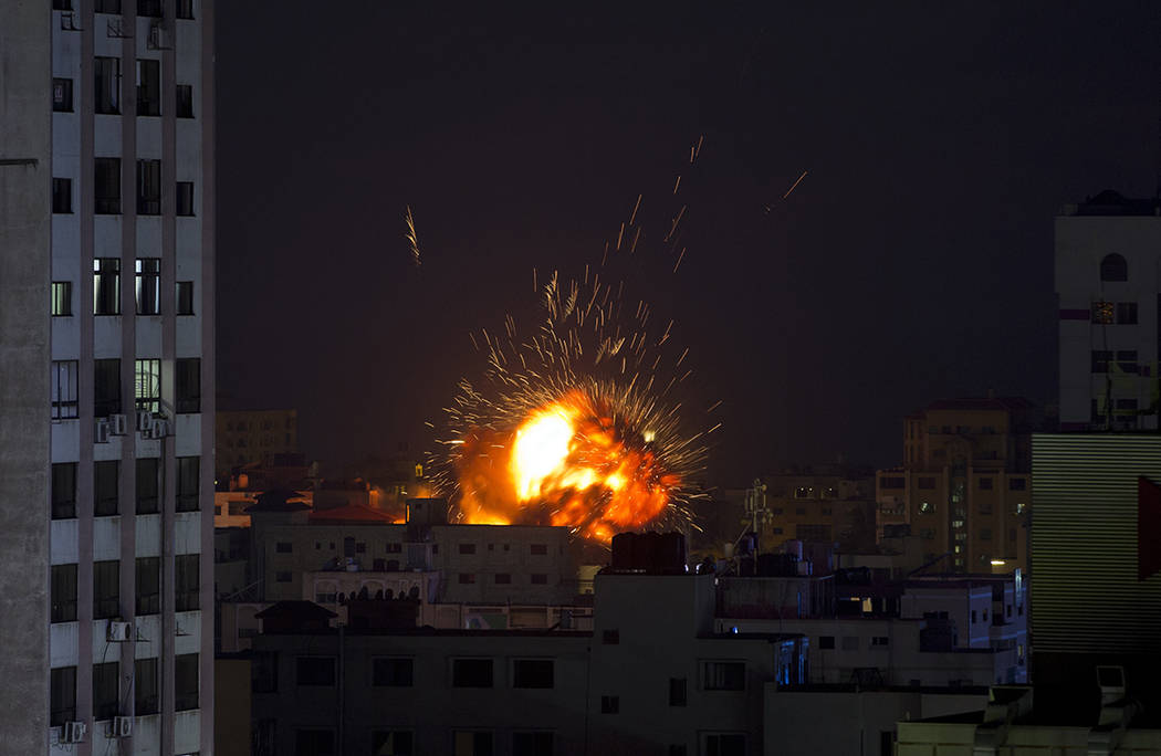 An explosion caused by an Israeli airstrike on a building in Gaza City, Saturday, May 4, 2019. ...
