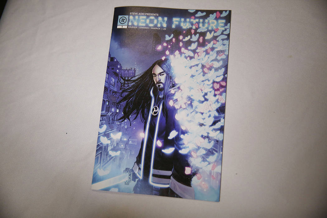 """A copy of Steve Aoki's new comic book """"Neon Future"""" is seen at his signing at Multive ..."""
