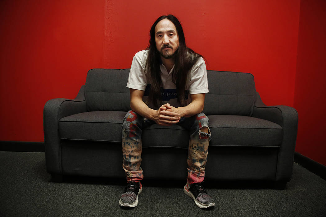 """Steve Aoki sits for a portrait during a comic book signing of his new comic book series """"N ..."""