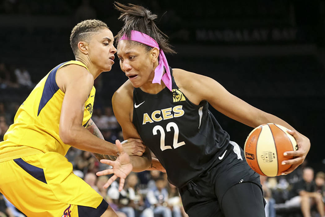 Las Vegas Aces center A'ja Wilson (22) drives the ball against Indiana Fever forward Candice Du ...