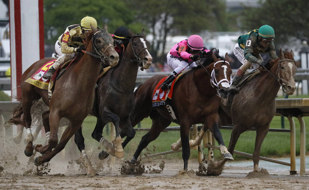 Flavien Prat on Country House, left, races against Luis Saez on Maximum Security, second from r ...