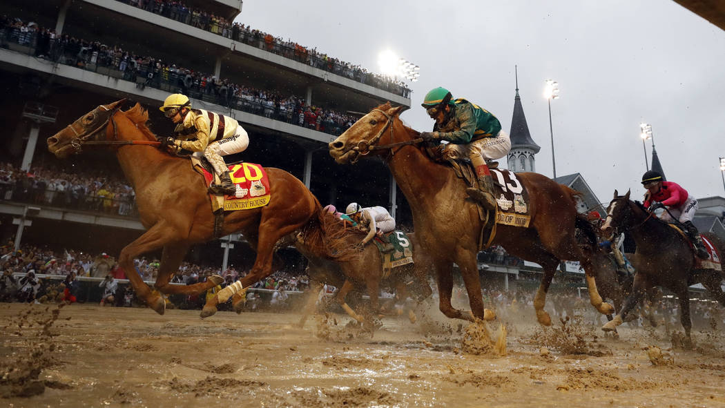 Flavien Prat rides Country House to victory during the 145th running of the Kentucky Derby hors ...