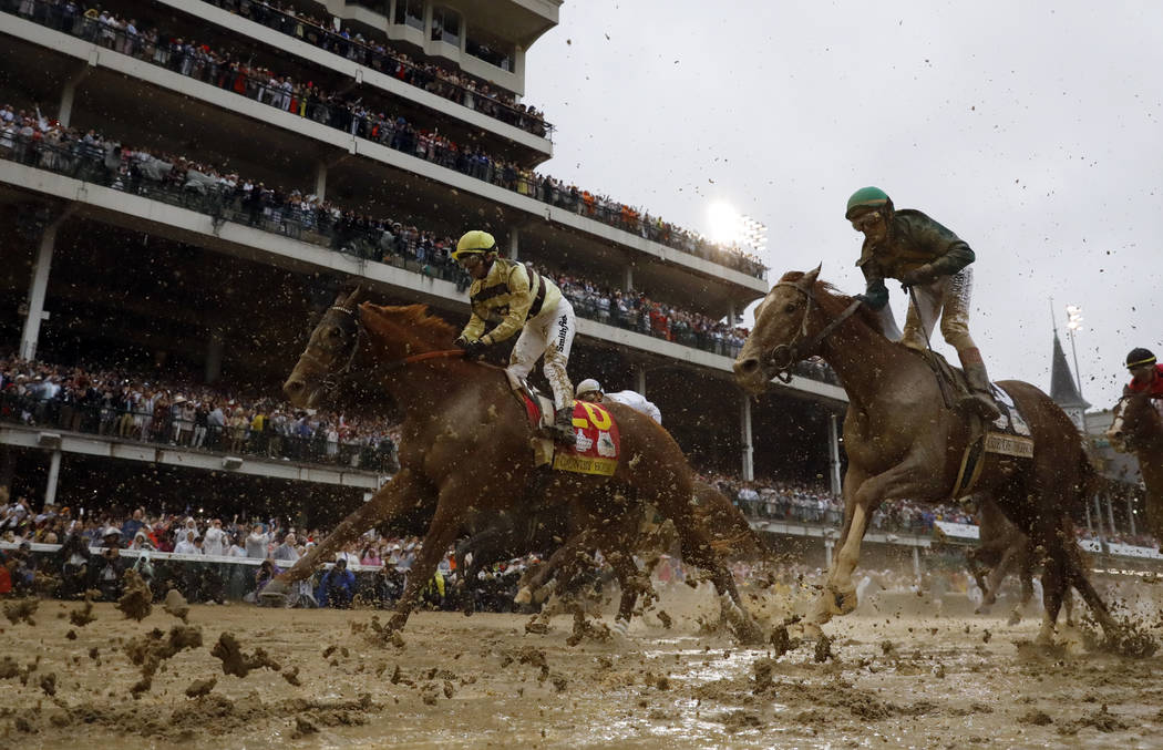 Flavien Prat rides Country House to the finish line during the 145th running of the Kentucky De ...