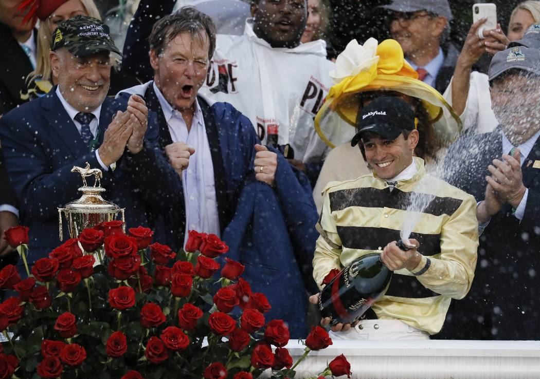 Flavien Prat celebrates after riding Country House to victory during the 145th running of the K ...