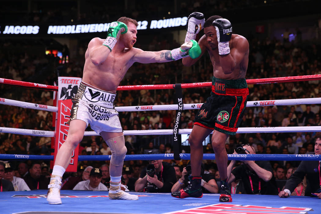 Saul Canelo Alvarez, left, battles Daniel Jacobs in the WBC, WBA, IBF, and Ring middleweight ti ...