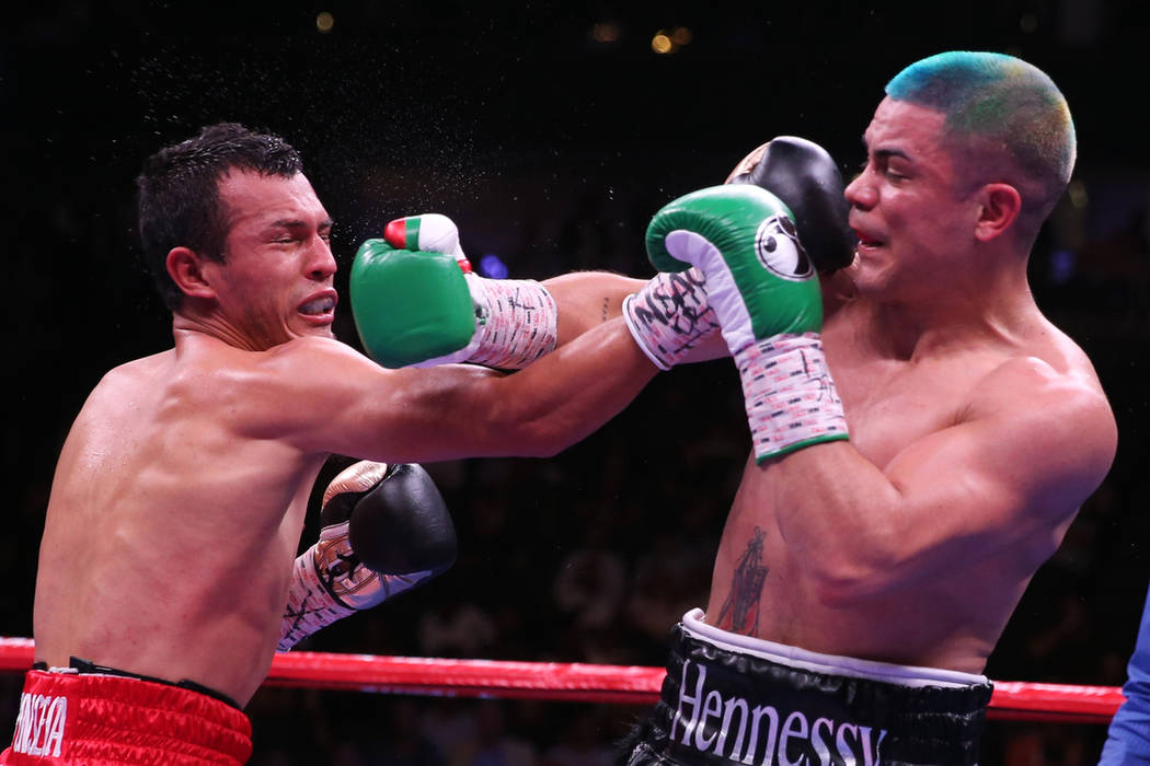 Joseph Diaz Jr., right, connects a punch against Freddy Fonseca in the super featherweight titl ...