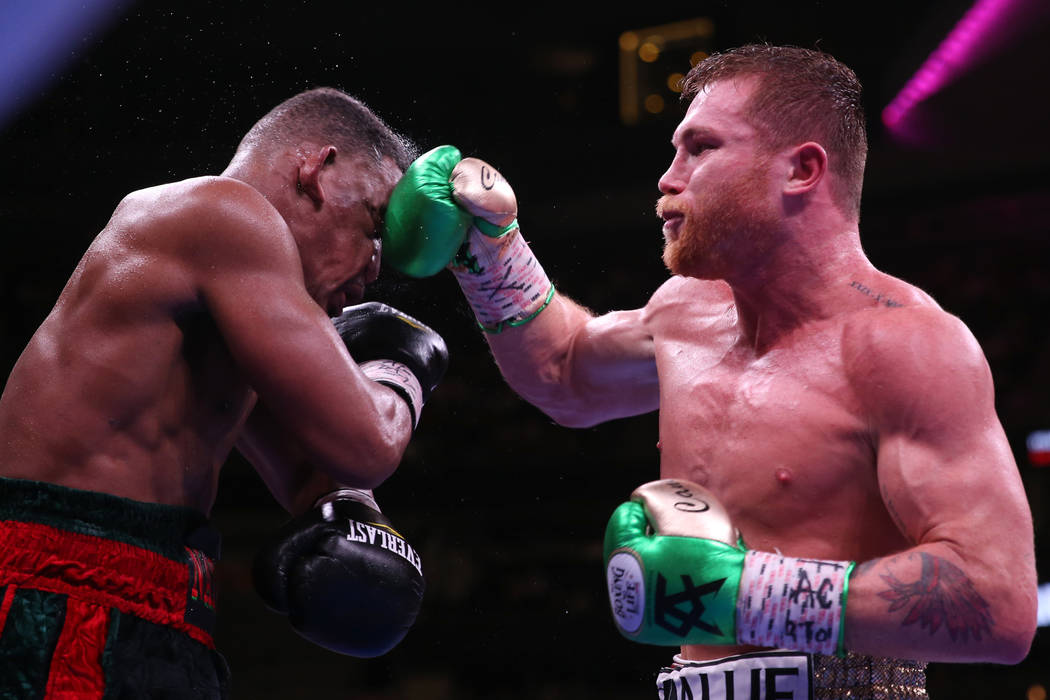 """Saul """"Canelo"""" Alvarez, right, connects a punch against Daniel Jacobs in the WBC, ..."""