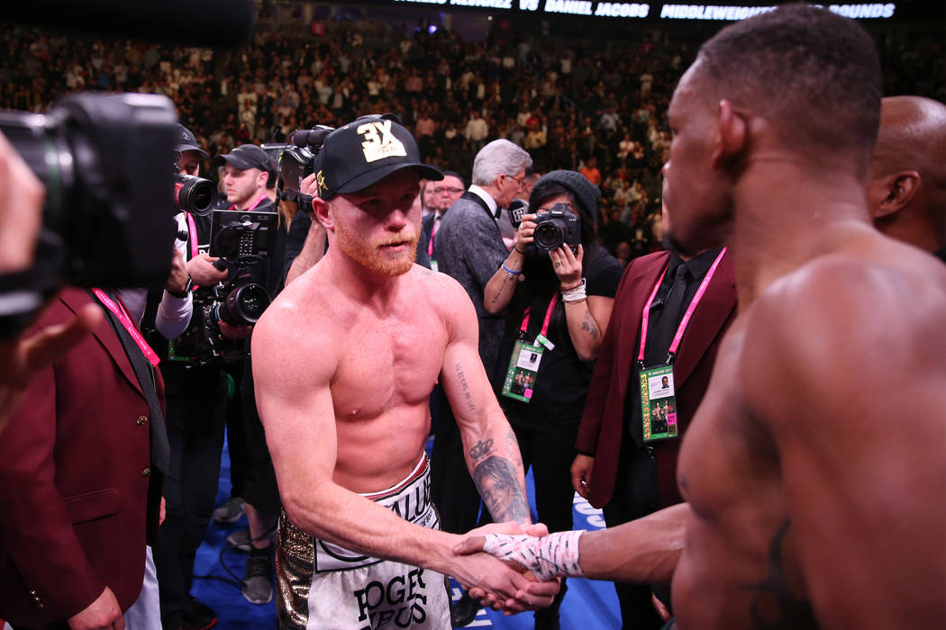 """Saul """"Canelo"""" Alvarez, left, shakes hands with Daniel Jacobs after their fight in ..."""