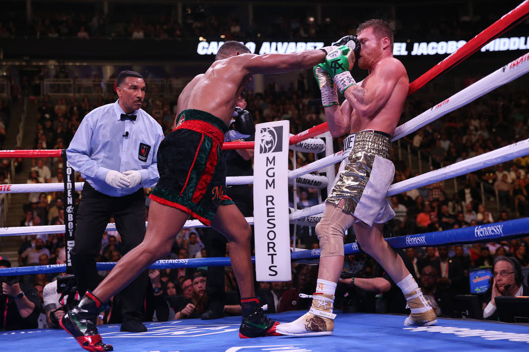 "Daniel Jacobs, left, connects a punch against Saul ""Canelo"" Alvarez in the WBC, W ..."