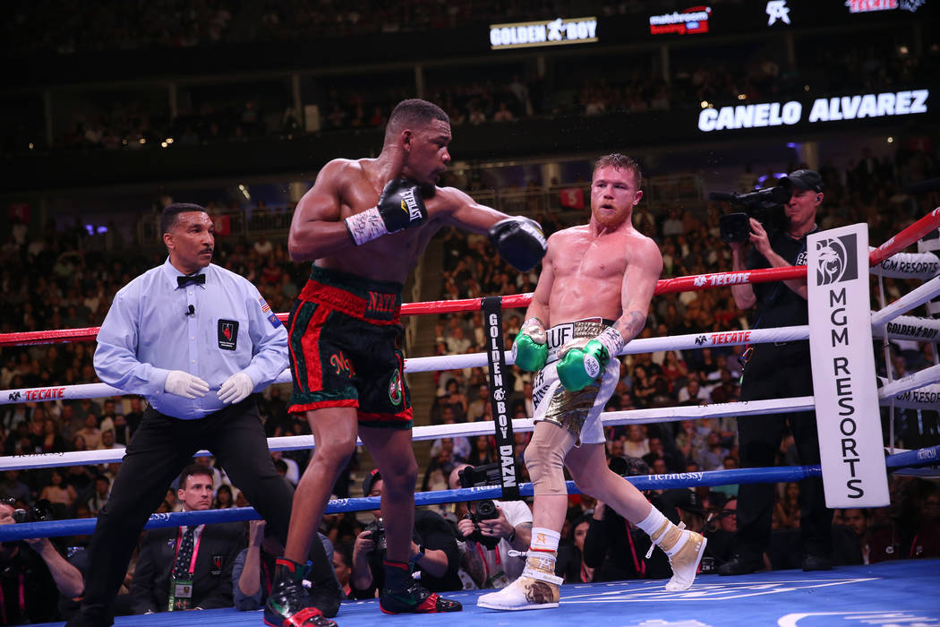 """Saul """"Canelo"""" Alvarez, right, moves away from a punch against Daniel Jacobs in th ..."""