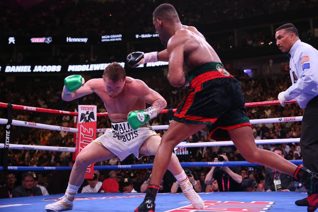 Saul ÒCaneloÓ Alvarez, left, moves away from a punch against Daniel Jacobs in the WBC ...
