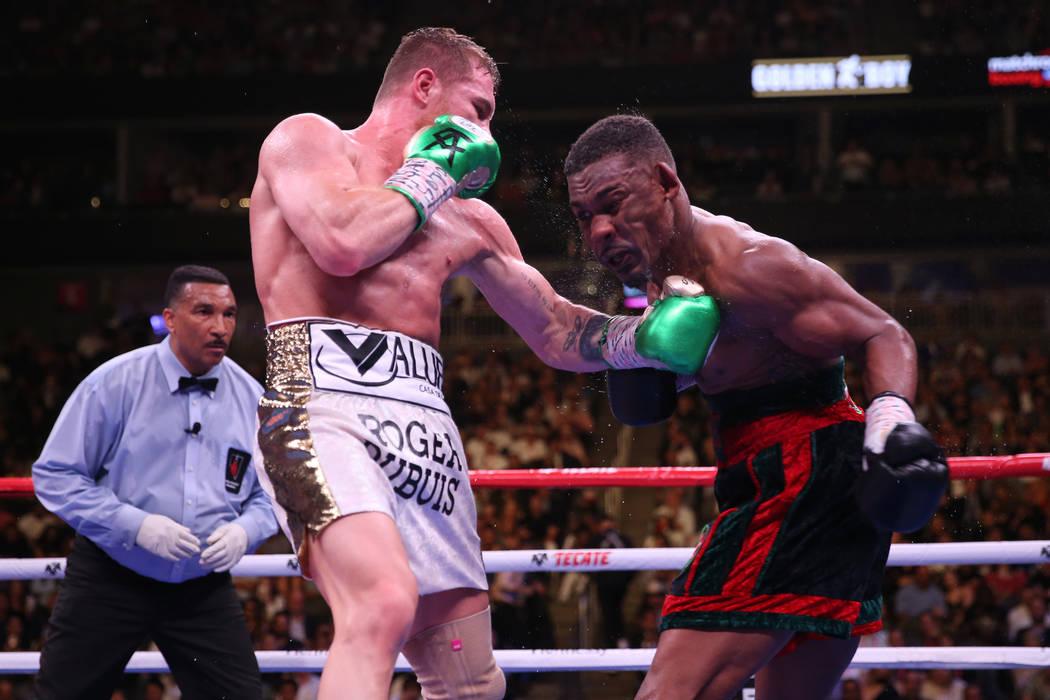 "Saul ""Canelo"" Alvarez, left, connects a punch against Daniel Jacobs in the WBC, W ..."