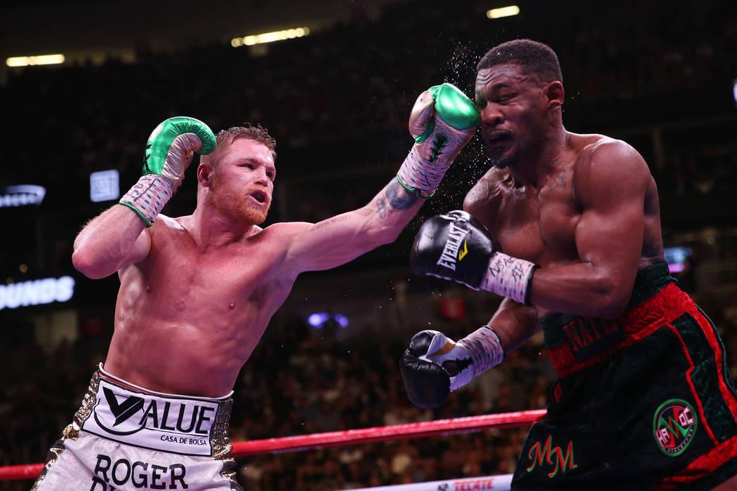 Saul ÒCaneloÓ Alvarez, left, connects a punch against Daniel Jacobs in the WBC, WBA, ...
