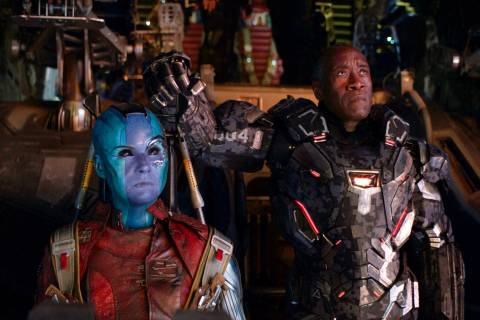 """This image released by Disney shows Karen Gillan, left, and Don Cheadle in a scene from """"A ..."""