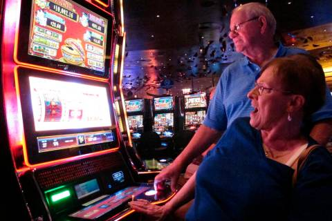In this June 25, 2018 photo, Joyce Green of Vineland, N.J. reacts to a winning spin at a slot m ...
