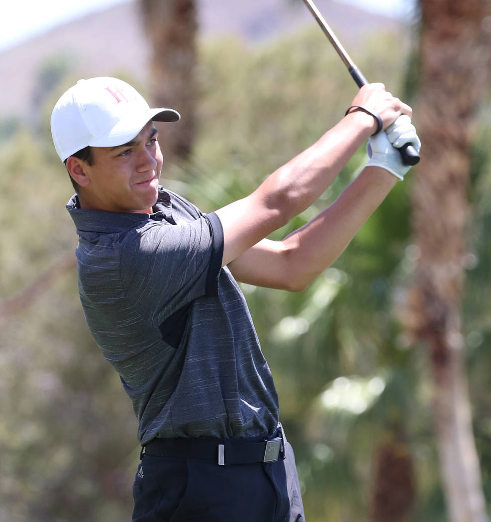 Faith Lutheran's Nick Desrochers watches his drive during the Nevada State High School Regional ...