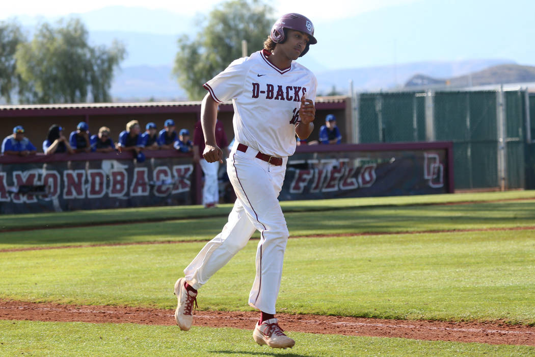 Desert Oasis' Campbell Holt (16) runs the bases after hitting a two run homer against Basic in ...