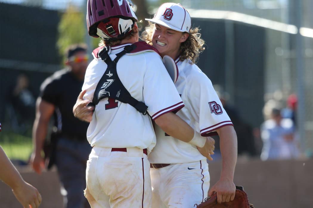 Desert Oasis' pitcher Colby Smith (11), right, embraces catcher Parker Schmidt (4) after striki ...