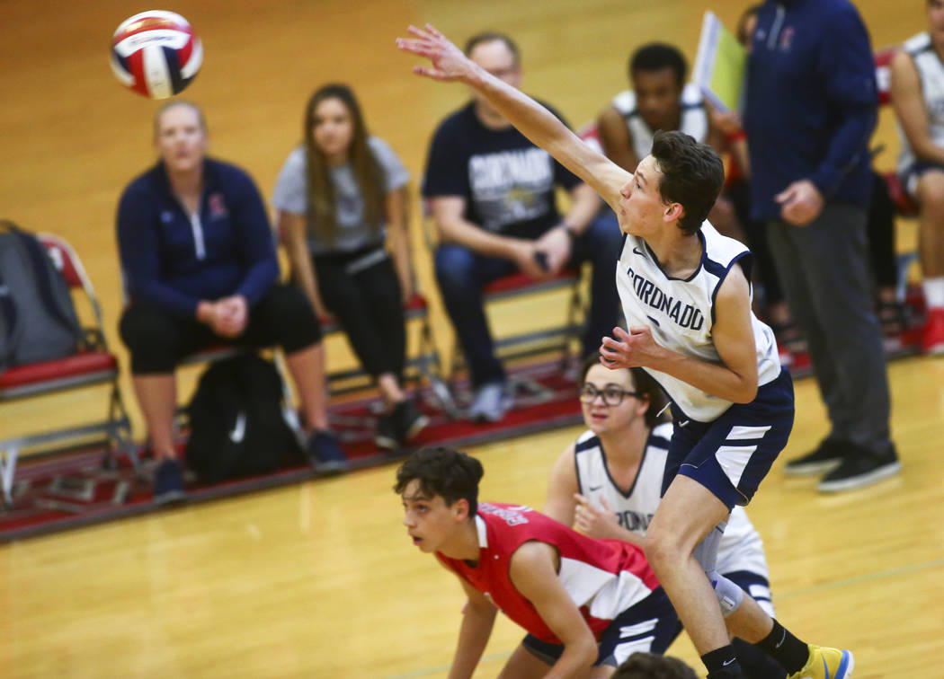 Coronado's outside hitter Alex Winiarczyk (9) sends the ball to Foothill during the Desert Regi ...